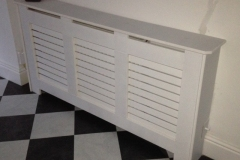 New England design radiator cover finished in satin white with a horizontal grille