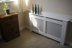 New England radiator cover finished in satin white with a Filigree white faced grille