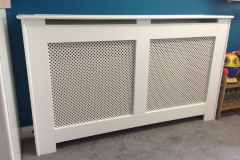 New England design cabinet finished in satin white with a nevada diamond design white faced MDF grille