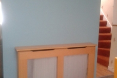 Old England radiator cover finished in beech veneer and clear satin lacquer with a silver alloy grille