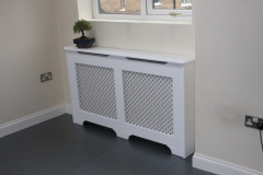 Old England design radiator cabinet finished in satin white with a Oregon white faced grille