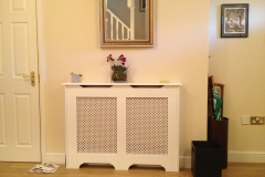 old England design radiator cabinet finished in satin white with a small cross white faced grille