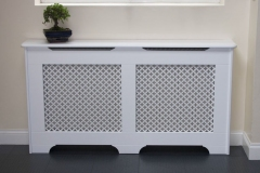 Old England design radiator cover finished in satin white with a oregon white faced MDF grille