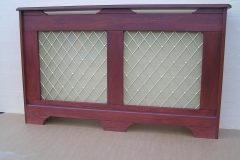 Studley design radiator cabinet finished in a mahogany stain with a regency brass grille