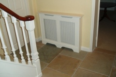 Studley design radiator cabinet finished in satin white with a white faced filigree grille