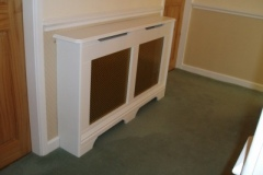 Studley radiator cabinet finished in satin white with an alloy pattern grille design