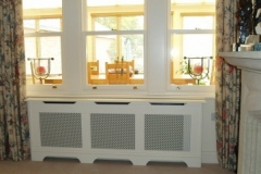 Studley (traditional) radiator cabinet design finished in white with a white grille panels
