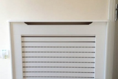 Studley design radiator cover with a horizontal grille on the front panel