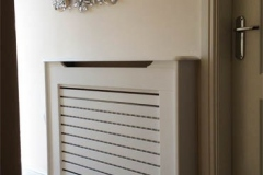 Studley design cabinet finished in satin white with a horizontal grille design on the single opening vent