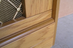 Studley design radiator cover in our oak veneer finish with a regency brass grille lower decorative rail