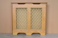Studley design radiator cover in our oak veneer finish with a regency brass grille