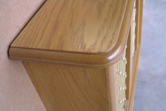 Studley design radiator cover in our oak veneer finish with a regency brass grille top shelf profile