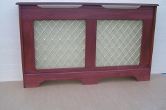 Studley design radiator cabinet finished in Mahogany stain and a regency brass grille