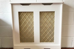 Studley design radiator cover finished in satin white with a Regency brass grille 54mm diamond alternate floral rosette and a fine backing mesh