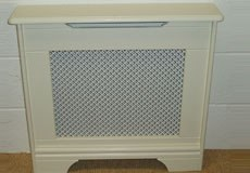 Studley design finished in antique white with a pattern grille also painted antique white (cream)