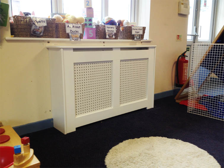 radiator cabinet used over a storage heater for child safety feature