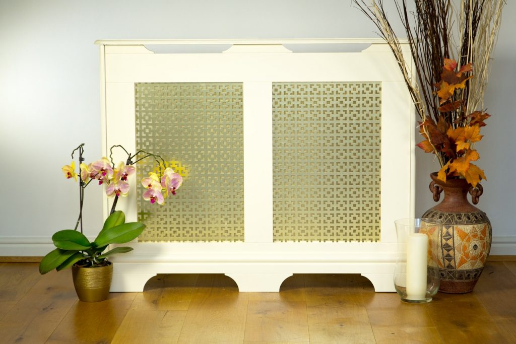 traditional design Studley radiator cover finished in antique white with a gold effect alloy grille